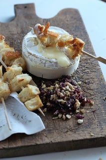 Hot camembert with cranberries and roasted hazelnuts
