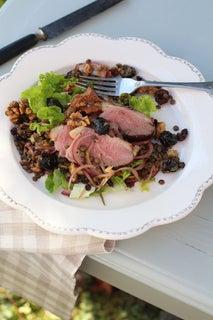 Grilled duck breast on lentil, olive and walnut salad