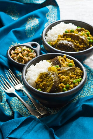Eggplant curry with peanut and coriander sprinkle