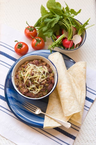 Mexican frijoles with radish and tomato salad