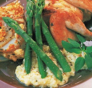 Lemon-roasted poussins, chicken or turkey breasts with bread and herb garlic sauce