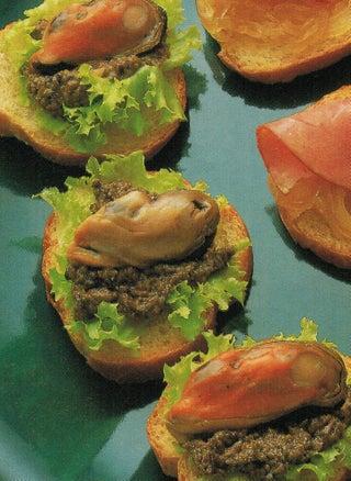 Smoked mussel on tapenade crostini