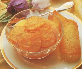 Caramel oranges with lemon tuile biscuits