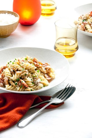 Pasta with walnut sauce and bacon