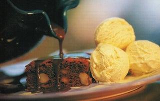 Macadamia fudge brownies with vanilla ice cream
