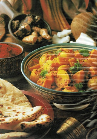 Pumpkin and potatoes with tomato