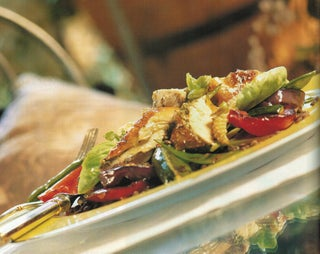 Basil chicken on salad of grilled and marinated vegetables