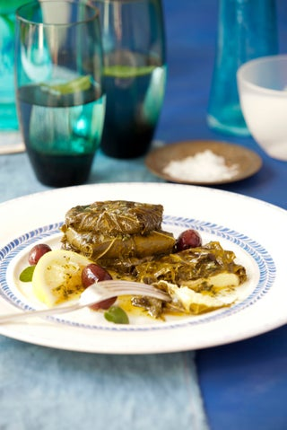 Grilled halloumi in vine leaves