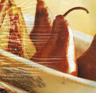 Baked pears with dates and orange rind served with English custard