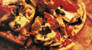Aubergine and feta pizza with basil oil