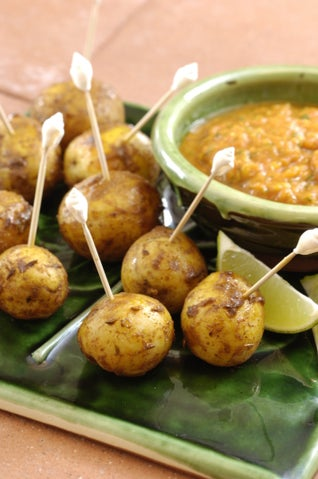 Indian spiked potato kebabs with tomato and lime dip