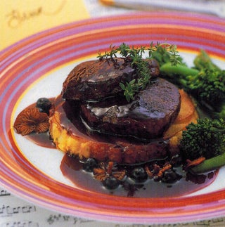 Venison steaks with bacon potato cakes and cassis