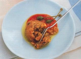 Pizza risotto balls with tomato and caper sauce