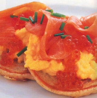 Blini with creamy scrambled eggs and smoked salmon