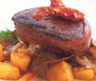Venison steaks with wild mushrooms
