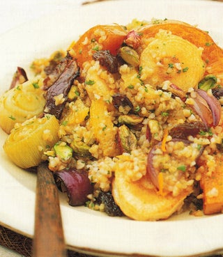Roasted autumn salad with orange and raisin dressing