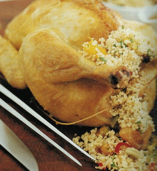 Roast Chicken With Fresh Date And Couscous Stuffing