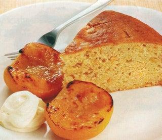 Citrus sour cream cake with roasted peaches.