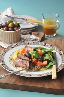 Moroccan lamb cutlets on olive couscous salad